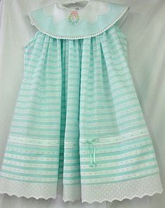 """Emma's Easter Dress"" by Connie Palmer! Connie used our aqua dotted swiss striped fabric, white swiss nelona for the collar, silk satin ribbon, and a sweet tiny Swiss edging to create this classy, beautiful dress. The dress is designed from Michelle's Madeira Dress pattern."