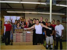 24-Hour Fitness Fremont Avenue location volunteers distributing produce at Sunnyvale Community Services.
