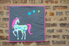 Add a little unicorn magic to your home with this easy appliqué mini quilt. #unicorn #iloveunicorns #unicornparty #mini #quilt #free #pattern #tutorial