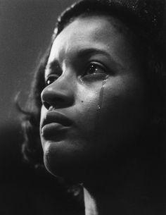 Myrlie Evers at her husband's Medgar Evers funeral, 1963