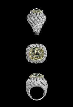Cartier - XXVIth Biennale des Antiquaires  Solar landscape: Ring - platinum, one 15.64-carat cushion-shaped yellow-light diamond, brilliants.