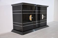 Art Deco Sideboard with Bright Yellow Interior   From a unique collection of antique and modern sideboards at https://www.1stdibs.com/furniture/storage-case-pieces/sideboards/