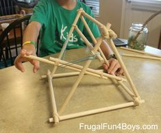 How to build a catapult out of dowel rods and rubber bands. Link to sponge splash bombs. Buy dowels, rubber bands, sponges, cable ties. craft sticks