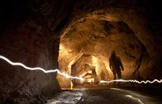 """How Cool Is That? - In a deep, icy Norwegian fjord, an abandoned mine may help solve the energy problems of the Internet - DEEP STORAGE A paved underground road called the Avenue gives access to rock chambers, or """"streets,"""" that will house server equipment - Photographs by Marcus Bleasdale - OnEarth Magazine"""
