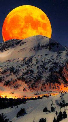 this is a awsome moon behind a mountain!!!!!!!!!!!!!!!!!!!