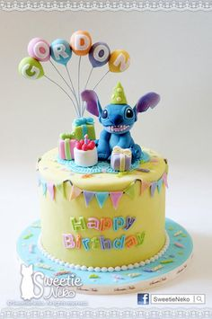 coloful cake with stitch in birthday party themed. www.facebook.com/sweetieneko