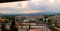 Sunset and the western Blue Ridge Mountains from the the World Coffee Cafe 'Sky Bar' ... 8 floors up in a 1920's style elevator in the Flatiron Building, located at 18 Battery Park in downtown Asheville.