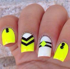 Image via   Neon nails and black studs