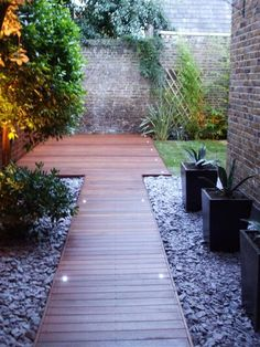 Decking - Landscape Garden Design and Build London love the idea of a deck pathway, and the lights are gorgeous in it