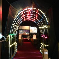 """Our """"Blast to the Past"""" time tunnel. Using pic, a tarp, and lots of rope lights!"""