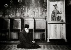 Neamt County, Romania July 2007  An Orthodox monk praying in the church of Neamt monastery.  Photo: Ezequiel Scagnetti
