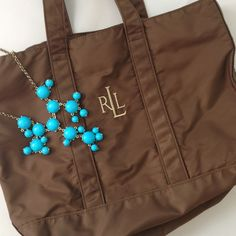 Lauren Brown Nylon Bag Carry all your summer essentials in a classic Ralph Lauren tote! Brown with gold monogram logo, perfectly clean inside and out, no flaws. Ralph Lauren Bags