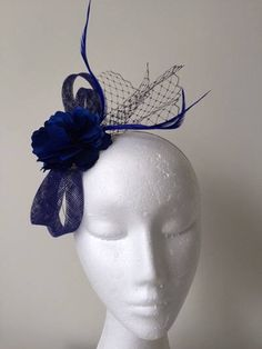 A personal favourite from my Etsy shop https://www.etsy.com/au/listing/540010253/cobalt-blue-sinamay-loop-fascinator-with
