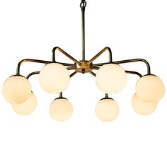 The Larenta Chandelier by Noir emphasizes natural, simple and classic design. Noir has been designing, building and importing a very unique, but ever growing collection of home furnishings for more than 10 years.  <i>Noir products are hand finished and created with a concentrated effort toward environmental sustainability. Variations could occur and are not considered as product defects.</i>  Material: Metal & Glass  Finish: Antique Brass