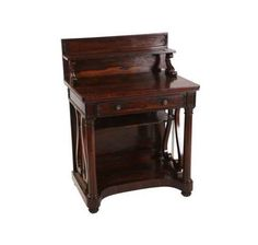 A small Regency rosewood chiffonier, in the manner of Gillows, the rectangular top with shelved superstructure supported by scroll carved supports, over a frieze drawer with moulded front and fitted with brass pulls, above a shelf flanked by opposing lyre ends and a pair of columns continuing to a platform base, moving in castors. 109.5cm by 79cm by 54cm.