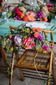 sweetheart chairs - photo by Kristen Weaver Photography http://ruffledblog.com/yucatan-inspired-wedding-ideas