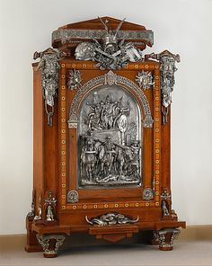 # Cabinet by Charles Guillaume Diehl,French (1811-1885) Mounts and large central plaque by Emmanuel Fremiet. Designer Jean Brandely (French 1856-67) Oak,veneered with cedar,walnut,ebony and ivory,silvered-bronze mounts.