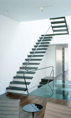 cantilevered stair, glass & wood flooring