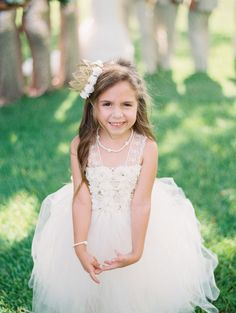 Adorable crowned flower girl: http://www.stylemepretty.com/texas-weddings/burleson/2015/11/10/gold-silver-texas-glam-wedding/   Photography: Becca Lea - http://beccalea.com/