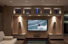 We love the way Hanson Audio Video in Dayton has used the recess in the wall to their advantage in framing out this big screen tv and speakers. #mancave www.hansonav.com