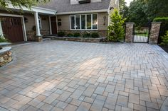 Get creative! Add a pattern or border to your driveway. With Cambridge, creativity is unlimited. This driveway on Long  Island was updated by Fine Design Landscaping using Cambridge Pavingstones with ArmorTec.