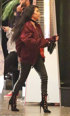 She's got style: The 36-year-old wore an oversized 'Life of Pablo' bomber jacket with leather pants and laser cut heels
