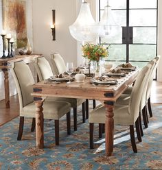 The simple yet stunning look of neutral, linen upholstered dining chairs dresses up a table without being too bold. The profile of the chairs features a uniquely curved top as well as nailhead trim for just enough style.