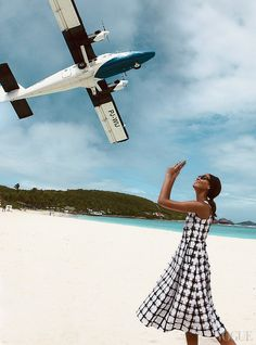 CLEARED FOR TAKEOFF - St. Barth's tiny Gustaf III Airport is tucked in tight next to St. Jean beach—giving Smalls (and Demarchelier) a tailor-made photo op. Marni check-print dress, $2,160; select Neiman Marcus stores. In this story: hair, Jimmy Paul for Bumble and Bumble; makeup, Christian McCulloch. Produced by Float & Shoot, St. Barth's. Details, see April's In This Issue.
