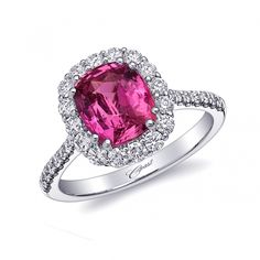 This gorgeous ring features a 2.67CT pink sapphire surrounded by an elegant diamond halo, and diamonds on the shank. Set in 18K white gold.