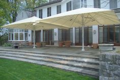 The addition of beautiful Jumbrellas add shade to any deck or patio.