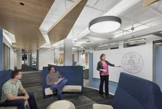 Goldman Ismail's Chicago Law Offices / NELSON  Open collaborative hub in a hallway