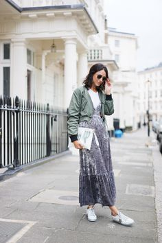 Try wearing two of your favourite trends at once like blogger Soraya Bakhtiar. A bomber jacket adds a cool edge to this velvet dress and t-shirt combo.
