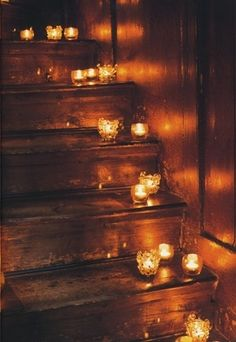 There is something earthy and human about a house in candlelight. Even front the outside steps.