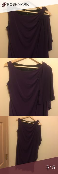 Purple Dress I absolutely love this deep purple dress. It always makes me feel beautiful and chic when I've worn it. This sleeveless dress has extra material on one side that can either be draped in the front or the back, both look great and has a drape effect near the hem line. It does have a tiny spot on the front the looks to be some sort of glue or something, but I'm sure some brilliant clothing mastermind can take care of that in no time! Valerie Bertinelli Dresses