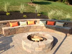 Backyard entertaining area: Outdoor built in fire pit with retaining wall and built in seating. S'mores anyone?