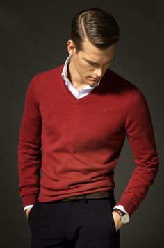 Red sweater, white shirt with blue dress stripes, navy pants