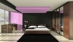 The colour combination is amazing. The light purple accent colour on the wall and ceiling is a perfect foil for the black, grey and brown furniture in the bedroom