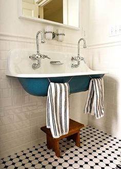 blue trough sink in kids bathroom