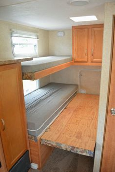Add some hinges and a fold-out wooden bed frame to the bottom bunk in an RV, plus another foam mattress, and you turn a single bunk into a double bed!