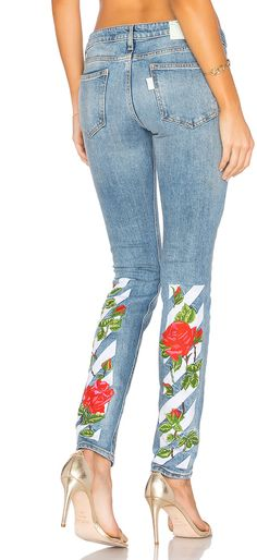 OFF-WHITE Diag Roses 5 Pocket Skinny Jeans | For denim that's anything but mundane, turn to this embellished pair by OFF-WHITE. A tried-and-true skinny fit with a flattering mid-rise, they're made exceptional by the label's signature stripe embroidery with roses snaking up the backs of the calves. | #fashion #style #glam #outfit #stylish #casual #floral #ootd #denim