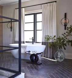 Bathroom inspiration. Herringbone slate and crittall, softened with linen blend curtains #homeinspiration #interiorinspiration #interiordesign #luxuryhomes #homedesign #homedecor #bathroomideas #bathroominspiration #luxurybathroom #herringbone