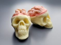 The Skull Truffle project at Make involves making your own skull molds out of silicone. It's a wonderful guide for those who want to do that, but the relevant effect is a walnut half covered in pink candy melt to look like an exposed brain. You can buy skull molds, or if you are in a hurry, you can skip to step 15, the part about making little brains out of walnuts.