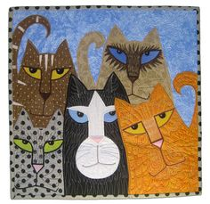 """A Passion for Purrfection"" by Sheila Rauen (Tennessee). Cottons, applique, free motion embroidery and quilting: ""This quilt was inspired by many of my passions:  animals, pattern, color and surface design."""