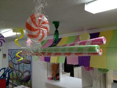 VBS 2013 Colossal Coaster World, Cotton Candy Cafe awning, & hanging hard & stick candies. Eternal Faith Baptist, Manor, TX