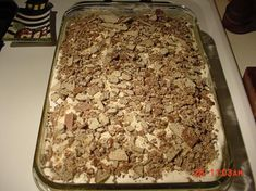 """We call this """"better than sex cake"""", and we mix the caramel sauce and sweetened condensed milk before pouring it on. Then we also use crushed Heath bars instead of nestle crunch."""