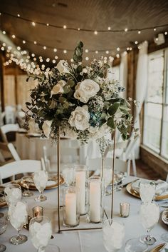 Modern tall wedding centerpiece with a neutral color palette and lots of greenery Photographer Ashtyn Brooke Photography Venue Cross Creek Ranch crosscreekranchfl ccrweddings carriagehousestable modernwedding modernweddingdecor moderncenterpiece Modern Wedding Centerpieces, Wedding Table Centerpieces, Floral Centerpieces, Wedding Reception Decorations, Centerpiece Ideas, Wedding Table Flowers, Candle Centerpieces, Flowers For Weddings, Table Decor Wedding