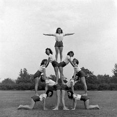 @Kathy Chan Andreoli | Group of teenage girls from Hoover High School doing a pyramid in gymnastics