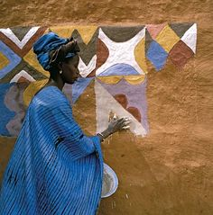 Ndebele woman of West Africa painting her home. Photo from African Canvas by Margaret Courtney-Clarke