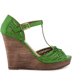 Meet up with the Milk Shake and create fashion magic. This Restricted sandal showcases a bright green leather upper with playful cut outs and feminine bow. Delivering perfection is a cute t-strap, 4 1/2 inch wedge and 1 inch platform.