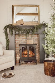 Farmhouse style Christmas bedroom decor with a beautiful faux brick fireplace mantel painted in Farrow and Ball Downpipe real cedar garland a golden mirror and so much more. Such a cozy space full of elegant and effortless Christmas decor! Farmhouse Fireplace Mantels, Brick Fireplace, Fireplace Design, Farmhouse Decor, Farmhouse Style, Fireplace Ideas, Bedroom With Fireplace, Fireplace In Kitchen, Faux Mantle